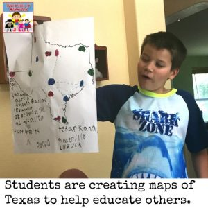 holding up map for Texas geography unit