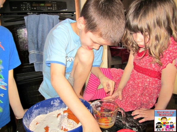 pumpkin spice scone mixing with the kids
