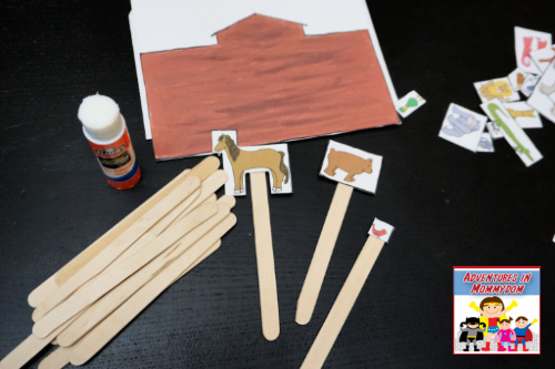 putting together the Noah's ark popsicle stick craft