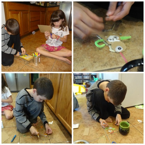 putting together their gingerbread pirate ornaments