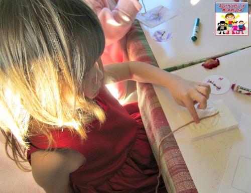 step 1 in the Daniel Boone lesson putting glue on the foam board