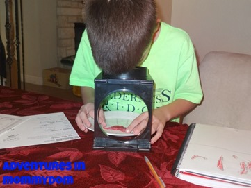 using a magnifying glass to observe muscles