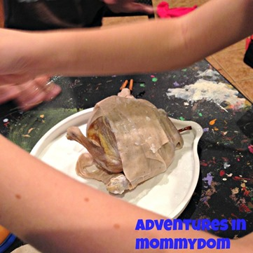 wrapping a chicken mummy
